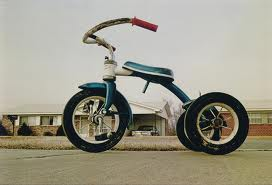 """Tricycle (Memphis)"", around 1975, printed 1980, by William Eggleston"