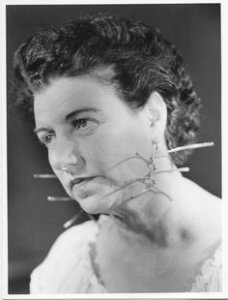 Peggy Guggenheim wearing earrings by Alexander Calder